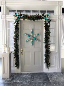 And here is a garland over a front door - so pretty embellished with more of our holiday decor. Be sure to visit The Home Depot soon and see all the holiday decorations we offer. Happy holidays!