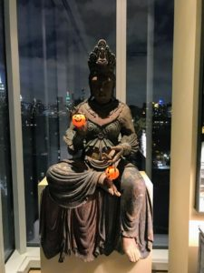 Here is a Guan Yin Buddha - she is sitting near Kevin's bedroom holding two small plastic pumpkins.