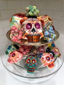 "And ""Day of the Dead"" skulls sat on cake stands nearby."