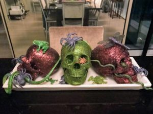 Kevin covered these skulls in Martha Stewart Crafts Glitter and used them as table centerpieces - in the classic Halloween colors of purple and green. http://www.michaels.com/