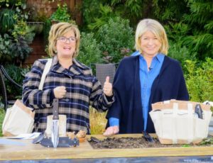 Here I am with QVC host, Carolyn Gracie. We're showing my new Heavy Duty Garden Bag with three tools - perfect for the gardeners on your list. I love this bag - it has nice long handles, so it can be carried over the shoulder around the yard.