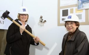 Here I am in 2007 breaking new ground with Mom, to whom I dedicated the Center.