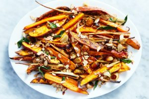 My Roasted Root Vegetables with Brown Butter, Sage and Almonds will definitely have guests asking for more. It includes sweet potatoes, carrots, parsnips, pearl onions, garlic and herbs - all topped with decadent brown butter.