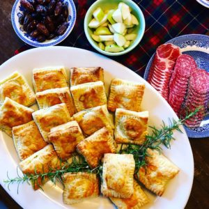 The day after Thanksgiving, Mary's family feast continued with a spread of spanakopita hand pies, charcuterie, dates and pears.