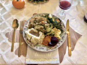 """Senior designer, Tiffany Fung, submitted this wonderful image. """"My family and I are vegan, but my mom still makes all the Thanksgiving classics, even my grandmother's stuffing recipe, by easily switching out a few ingredients for plant-based ones. We also had our favorite stuffed turkey-less roast."""""""