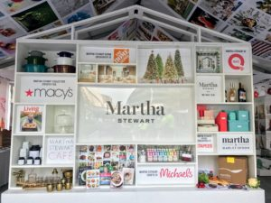 "The first thing visitors see when they enter our Martha Stewart Experience Pavilion is the grand ""Wall of Martha"" featuring our partnering brands, including Macy's, The Home Depot, QVC, Martha Stewart Wine Co., Martha & Marley Spoon, and more. Our set-up crew works very hard to create these beautiful displays."