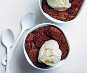 In this image, our delectable Warm Chocolate Pudding Cakes are topped with just a dollop of vanilla ice cream.