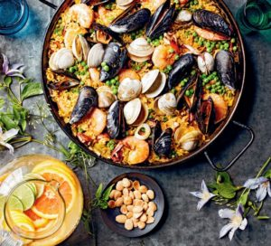 Another recipe from the book - my Paella, made with Spanish Bomba rice, which absorbs all the liquids and rich flavors without becoming too sticky.