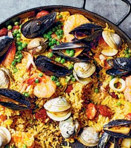 Here's a closer look showing these delicious ingredients - rice, chorizo, squid, shrimp, mussels and littleneck clams - everything you love in a tasty and flavorful paella.