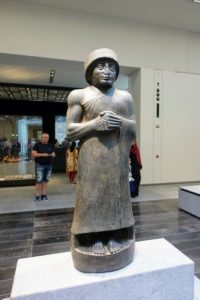 This is the Statue of Gudea, prince of Lagash, praying, circa 2120 BC. It is made from diorite, an igneous rock composed of minerals.