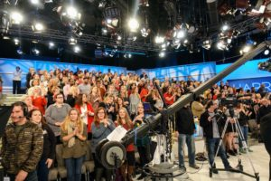 The day's audience was very enthusiastic and eager to learn new holiday decorating ideas. The piece of equipment in the center is called a jib, which is used to maneuver a camera from up high, giving viewers a varied perspective of what is shown on set.