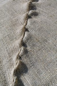 Nice sewing, Chhiring. Every member of the outdoor grounds crew knows how to sew very well - they get lots of practice.