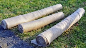Rolls and rolls of burlap are needed to cover my hedges and shrubs each winter. After every season, any burlap still in good condition is labeled and saved for use the following year.