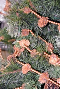 This tree is adorned with simple yet decorative pinecone garlands.