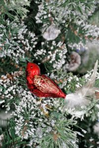 On another Christmas tree, Laura placed lots of bird ornaments, like this red one.