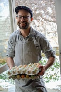 Jason brings in the eggs for all the cookies we're making - all these eggs are from my wonderful chickens.