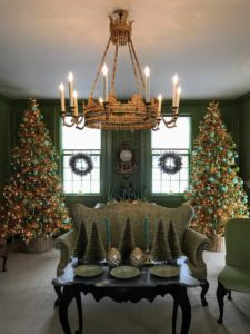 My Green Room is just off the foyer. Laura decorated this sunken parlor in gorgeous gold and green. I love these two trees filled with ornaments - they just light up the room.