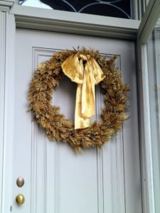 Here's a pretty gold wreath on the door of my Summer House.