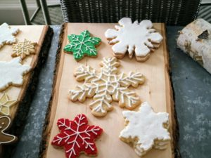 Here's a big favorite - iced sugar cookies. I love using natural elements in my decorating. We used very flat slices of wood to display our cookies.