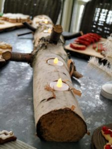 We made this candle holder from a log - it's perfect for holding our LED votive candles.