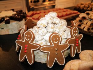 Here are gingerbread men standing around our Noel Nut Balls from our Martha & Marley Spoon Holiday Cookie Box.