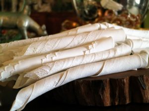 On the table is another lovely napkin display - simply rolled and piled neatly together.