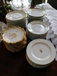 Whenever possible, always try to use real china. Here, we stacked a combination of white and white with gold plates for all the guests.
