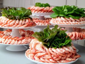 Our shrimp came from True North - 40 pounds of the freshest shrimp. We served it on cake stands garnished with lettuces from my garden - they look like flowers. http://www.truenorthseafood.com