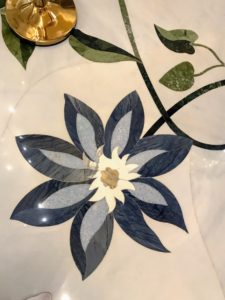 Here is a beautiful marble flower on the floor - one of many brightly colored mosaic and white marble low-relief floral displays designed by Kevin Dean, an artist and designer who has also worked for the Natural History Museum in London and the Smithsonian Institution in ­Washington.