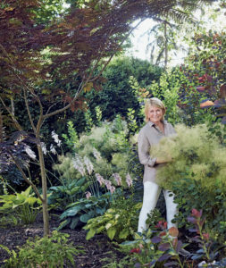 "Here is a photo from the book of me in my garden. The book talks about my love for gardening and how I worked alongside my father, helping him to cultivate the soil and grow beautiful healthy flowers in the gardens behind my childhood home. (Photo from ""Martha's Flowers"")"