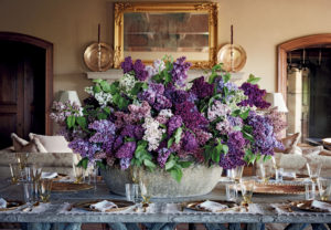 "The book gives lots of tips on designing and arranging - these are some lilacs that were picked and arranged by Kevin Sharkey at Skylands. I love this color palette of purple and lavender mixed with the bold green foliage. (Photo from ""Martha's Flowers"")"