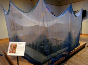 "This is called a ""futonji"" - traditional Japanese bedding which consists of a mattress, a cover and enclosed in netting to protect sleepers from mosquitoes. The Japanese made the netting out of handspan, handwoven hemp often dyed in indigo."