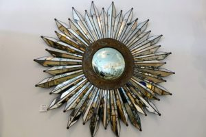 This is a beautiful decorative vintage Mexican sunburst mirror with a convex center and punched tin detail. It was made around the 1960s when this sunburst style was quite popular. It is on sale for 7800-dollars.