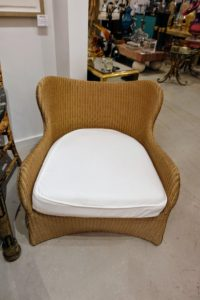 Here is a Vincent Sheppard chair. Vincent Sheppard has been designing and manufacturing indoor and outdoor furniture since 1992. Its headquarters are in Belgium, but many of its pieces are made in Indonesia, a country known for its rich tradition in weaving. https://www.vincentsheppard.com/