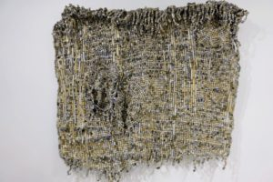 Here is a closer view - it is made of reclaimed computer keys and thread.