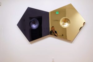 """This is called """"Zenithsluts (in Silver and Gold) a Gravity Well, no. 2"""", 2014 by Sinisa Kukec with acrylic mirror, red oak and other mixed media."""