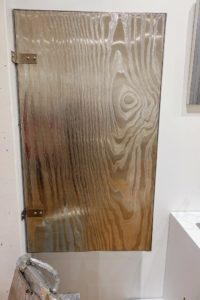 """In the Silver Room, I loved this piece called """"The Wood Be"""", 2007. It is by artist, Robert Beck, and is made out of CNC milled stainless steel, unreal screen and other hardware. And look closely - the pattern on the front is faux bois."""