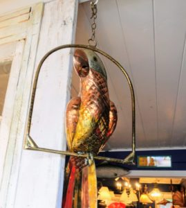 This parrot hangs from a doorway at Brass Scale Antiques - also made of mixed metals, brass and copper.