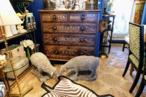 Judy always has such beautiful pieces in her shop - here is an English chest of drawers, a pair of stone sheep from France and a faux zebra print rug on the floor.