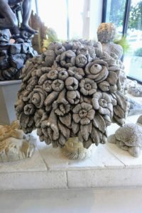 Here is a decorative floral piece made of stone.