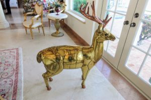 "Over the holidays, Lisbeth borrowed this standing three-dimensional reindeer from her sister, Judy, who owns Brass Scale Antiques. It is now back at the shop waiting for its ""forever home""."