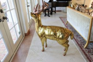 The reindeer's body is brass while its antlers are copper. After Sergio's pieces were displayed in New York City's Bergdorf Goodman Christmas window several years ago, the demand for his works soared.