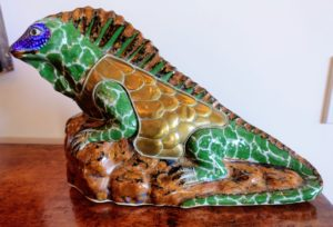 This iguana is made out of brass and ceramic - the green areas of his body are ceramic. Sergio also experimented with this medium in some of his works. Working with ceramic allowed him to add more color and form.
