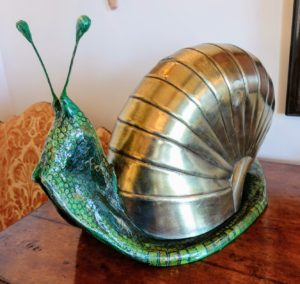 Here is the front of the snail showing more of the papier mache body. If you're not familiar, papier mâché is a composite material consisting of paper pieces or pulp, bound with an adhesive, such as glue, starch, or wallpaper paste.