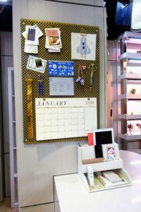 Here is a closer look at the board with a calendar, and all the notices and invitations that often pile up on the counter.