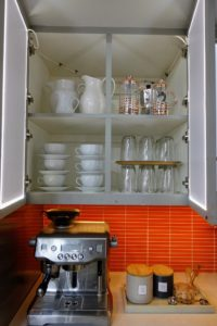 And, here is how I like to store my cups and saucers near my cappuccino maker - this way not only keeps them well organized, but it also saves vertical space, which can often be wasted in kitchen cabinets.