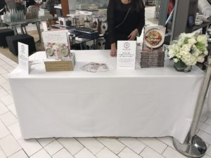 "We displayed ""Slow Cooker"" and Newlywed Kitchen"" nearby and for every customer who spent 50-dollars or more at Macy's, they received a book of their choice."