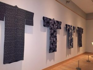 The clothing was so nicely hung in rows on the wall to show all the detailed stitching.