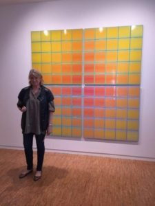 """Here I am standing in front of Victor Vasarely's """"Naini"""", c. 1960s - a colorful piece of acrylic paints on canvas."""