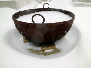 "This pot is one of two huge cast iron sugar kettles I keep as fire pits at the farm. They add such a nice accent to the landscape and have always been fun conversation pieces during gatherings. The snow created a ""snow pit"" for this great vessel."